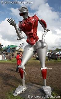 Mutoid Waste Company sculpture of a tall robot holding a reflective perfume ball in Trash City at Glastonbury Festival 2007. Pilton, United Kingdom. © 2007 Photographicon
