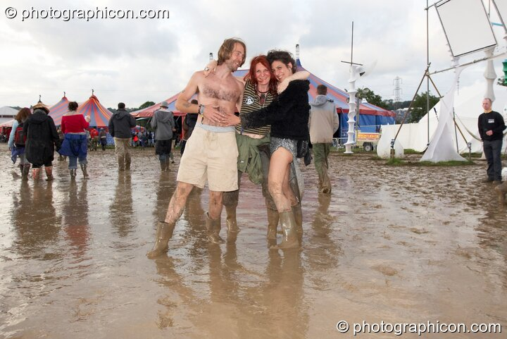 People walking in the mud in the Dance Village at Glastonbury Festival 2007. Pilton, United Kingdom. © 2007 Photographicon