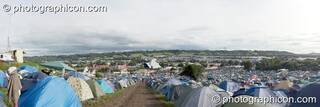 A panoramic view of tents camped near the pyramid stage at Glastonbury Festival 2007. Pilton, United Kingdom. © 2007 Photographicon