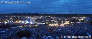 A night panoramic view of Glastonbury Festival 2007 taken from the the camping hill above the pyramid stage. Pilton, United Kingdom. © 2007 Photographicon