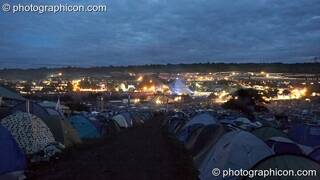 Night view of Glastonbury Festival 2007 taken from the the camping hill above the pyramid stage. Pilton, United Kingdom. © 2007 Photographicon