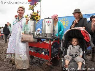 Two ladies sell tea from a trolley at Glastonbury Festival 2007. Pilton, United Kingdom. © 2007 Photographicon