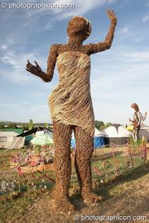 A large wicker statue of a woman in the Craft Field at Glastonbury Festival 2008. Pilton, Great Britain. © 2008 Photographicon