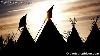The Tipi Village Silhouetted against the setting sun at Glastonbury Festival 2008. Pilton, Great Britain. © 2008 Photographicon