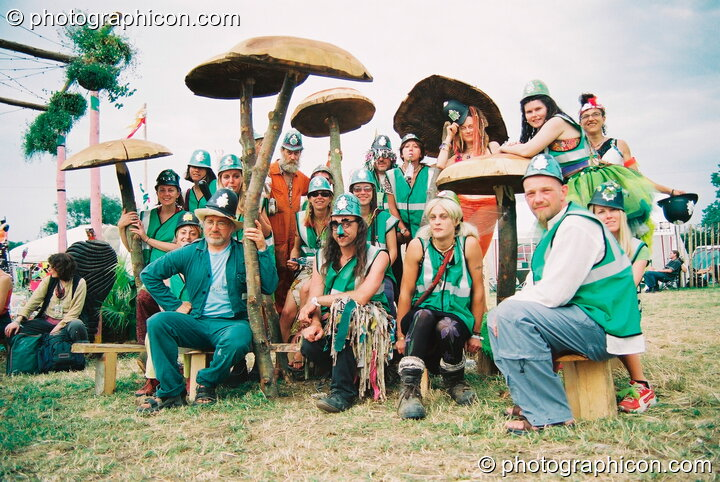 Group photo of the Green Police amongst the mushrooms at Glastonbury Festival 2003. Pilton, Great Britain. © 2003 Photographicon