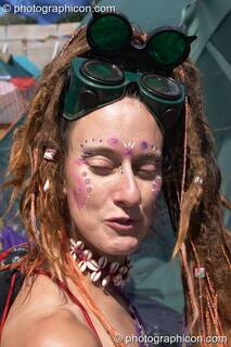 Green Police woman wearing welding glasses at Glastonbury Festival 2004. Pilton, Great Britain. © 2004 Photographicon