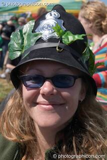 Woman Green Police officer wearing a decorated helmet at Glastonbury Festival 2004. Pilton, Great Britain. © 2004 Photographicon