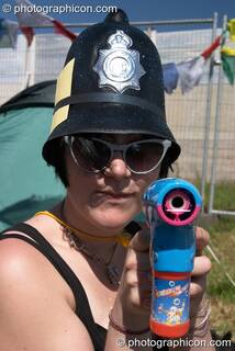 Armed woman Green Police officer at Glastonbury Festival 2004. Pilton, Great Britain. © 2004 Photographicon