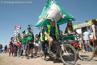 The Green Police pose with their Clean Green Support Machine at Glastonbury Festival 2004. Pilton, Great Britain. © 2004 Photographicon