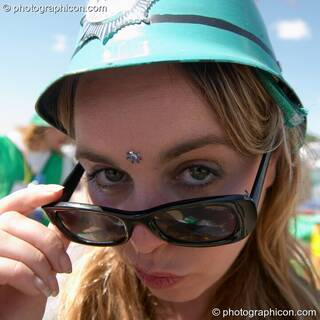 Green Police woman lowers her glasses at Glastonbury Festival 2004. Pilton, Great Britain. © 2004 Photographicon
