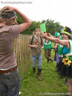 The Green Police make an arrest for pissing in King's Meadow at Glastonbury Festival 2005. Pilton, Great Britain. © 2005 Photographicon