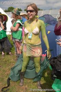 Woman in green body paint prepares her Green Police outfit at Glastonbury Festival 2005. Pilton, Great Britain. © 2005 Photographicon