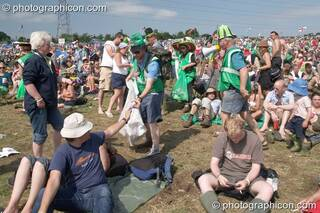 Green Police in action encouraging the public to pick up litter in the main arena at Glastonbury Festival 2005. Pilton, Great Britain. © 2005 Photographicon