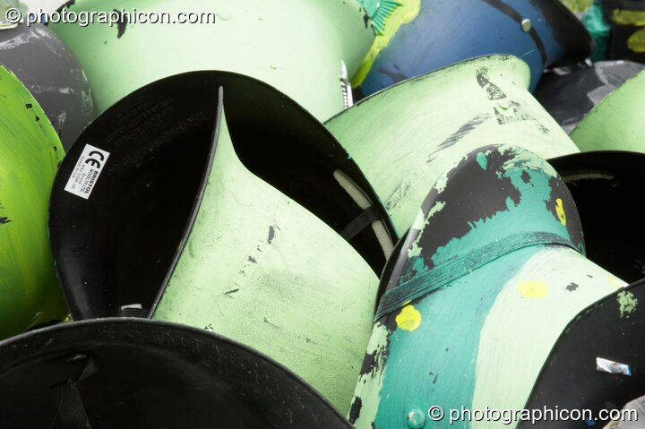 A pile of painted Green Police helmets at Big Green Gathering 2005. Burrington, Cheddar, Great Britain. © 2005 Photographicon