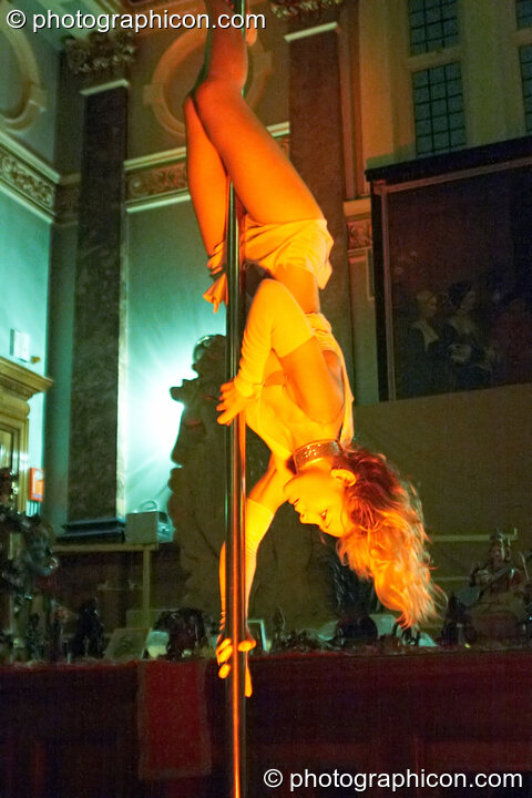 Ingrid Fluorotrash performs sensuous pole dancing at London Festival of Tantra 2009. Great Britain. © 2009 Photographicon