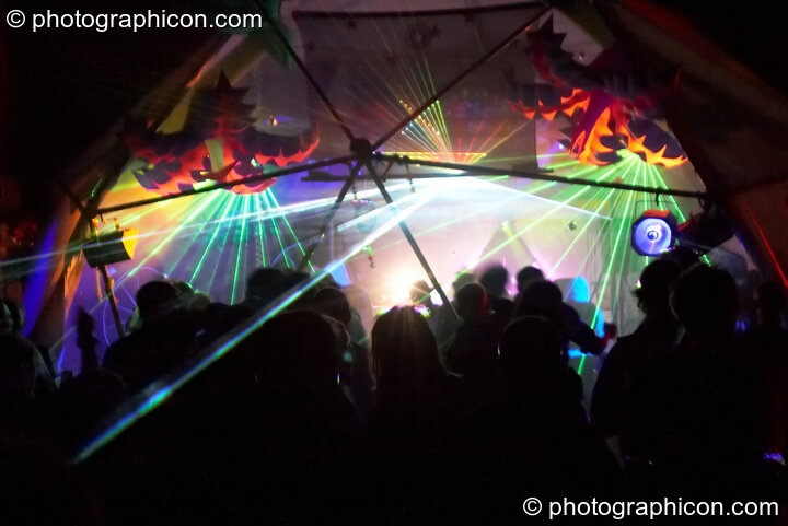 Lasers, decor, and dancers inside the Main Stage dome at Planet Bob's Offworld Festival 2007. Swindon, Great Britain. © 2007 Photographicon