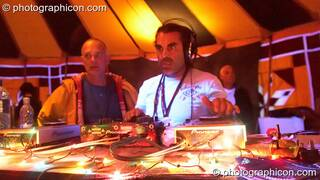 Paul looks on while Super Mario (FluffSquad/Planet Bob, Italy) DJs in the Progressive Tent at Planet Bob's Offworld Festival 2007. Swindon, Great Britain. © 2007 Photographicon