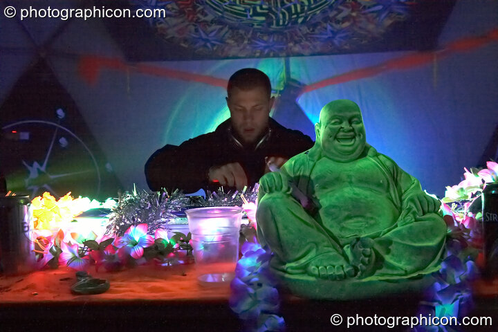 Moonquake (Nico Pianet - Hadra/Chrysalid, France/UK) DJs with a plastic Buddha on the Main Stage at Planet Bob's Offworld Festival 2007. Swindon, Great Britain. © 2007 Photographicon