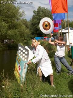 A campaigning group dressed in a giant eye draw attention to the politics of HIV medicine at the Secret Garden Party 2006. Huntingdon, Great Britain. © 2006 Photographicon