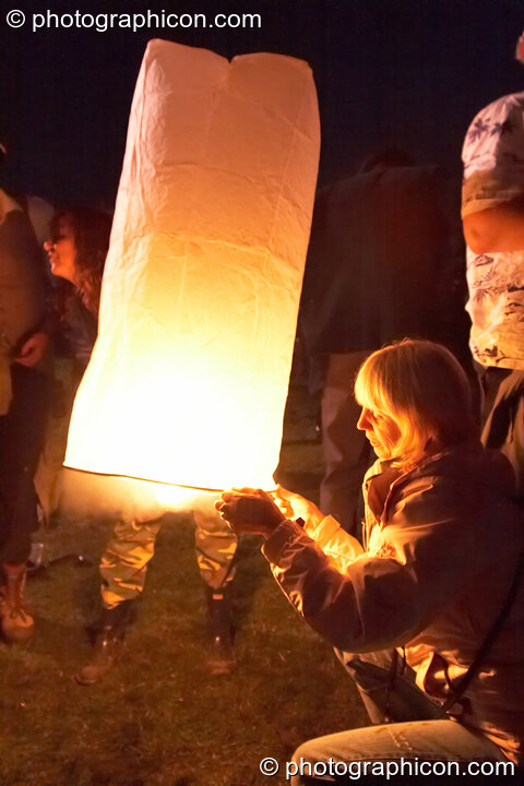 A small paper hot-air balloon is launched at the Secret Garden Party 2006. Huntingdon, Great Britain. © 2006 Photographicon