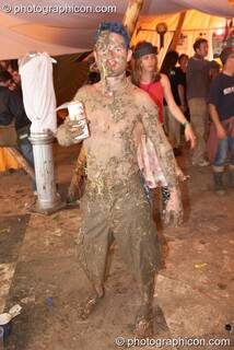 A man person covered in mud and straw at the Secret Garden Party 2006. Huntingdon, Great Britain. © 2006 Photographicon