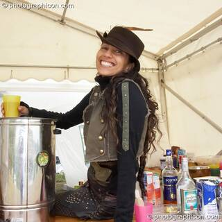 A lady serves behind the Nectar Cafe at the Secret Garden Party 2006. Huntingdon, Great Britain. © 2006 Photographicon