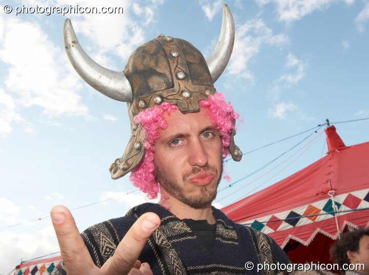 A man wearing a Viking helmet at the Secret Garden Party 2007. Huntingdon, Great Britain. © 2007 Photographicon