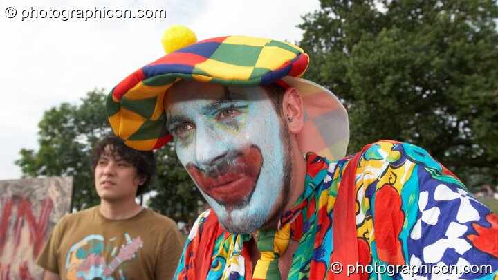 A man in scary clown costume at the Secret Garden Party 2008. Huntingdon, Great Britain. © 2008 Photographicon