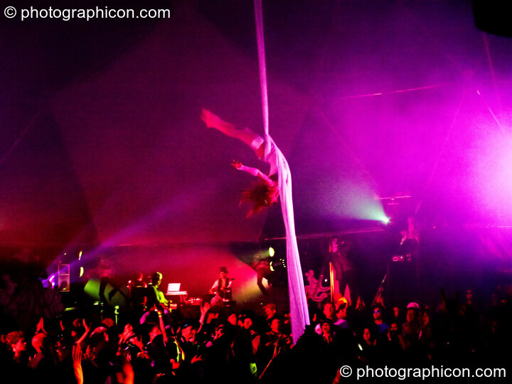 Claire O'Neill performs aerial silk acrobatics in the Remix Tent at the Secret Garden Party 2010. Huntingdon, Great Britain. © 2010 Photographicon