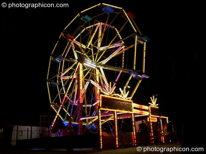 Night time view of the ferris wheel at the Secret Garden Party 2010. Huntingdon, Great Britain. © 2010 Photographicon