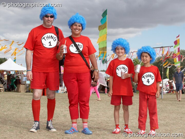 A family dressed as Thing characters from Dr. Seuss' The Cat in the Hat at the Secret Garden Party 2010. Huntingdon, Great Britain. © 2010 Photographicon