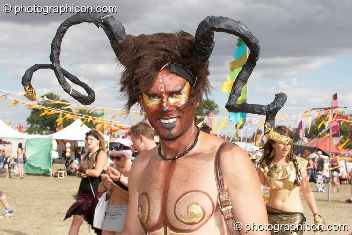 A man with tribal ram's horns at the Secret Garden Party 2010. Huntingdon, Great Britain. © 2010 Photographicon