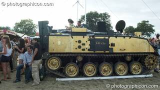 A DJ plays on the Tank stage (an armoured personnel carrier) at the Secret Garden Party 2010. Huntingdon, Great Britain. © 2010 Photographicon