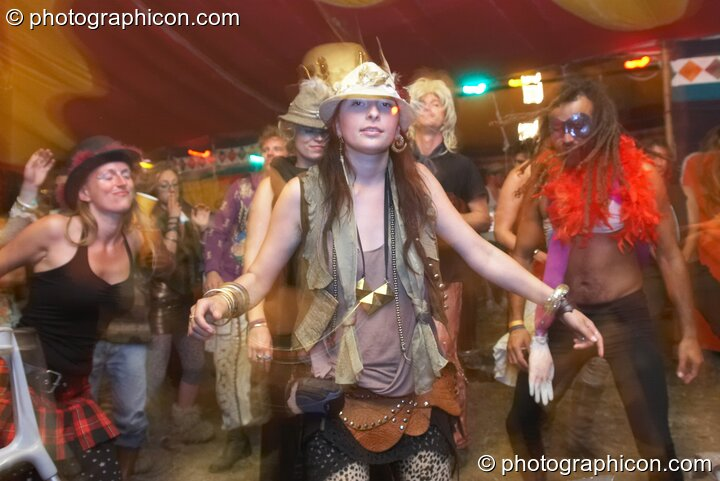 People in wonky costume dance in the Lizard tent at the Secret Garden Party 2010. Huntingdon, Great Britain. © 2010 Photographicon