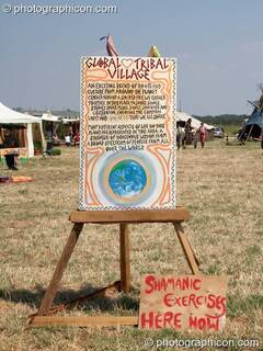 A sign advertising Shamanic exercises in the Global Tribal Village at Sunrise Celebration 2006. Yeovil, Great Britain. © 2006 Photographicon