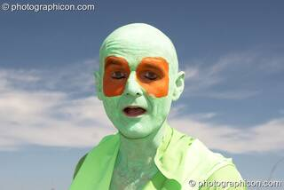 A man on a walkabout dressed as amphibian at Sunrise Celebration 2007. Yeovil, Great Britain. © 2007 Photographicon