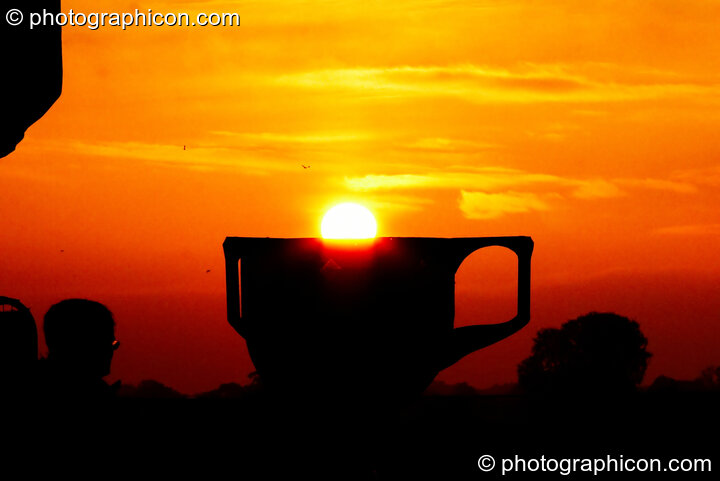 The sun rises over a giant chalice at Sunrise Celebration 2007. Yeovil, Great Britain. © 2007 Photographicon