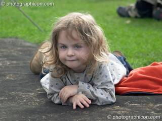 A young girl watches a concert by Sing For Water at the Thames Festival 2004. London, Great Britain. © 2004 Photographicon