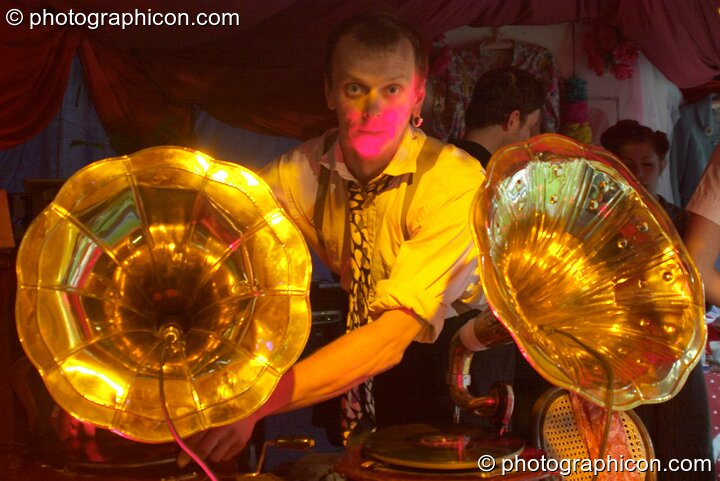 A man DJ's using a pair of wind-up 78 rpm gramophones in the Lost Vagueness tent at the Thames Festival 2004. London, Great Britain. © 2004 Photographicon