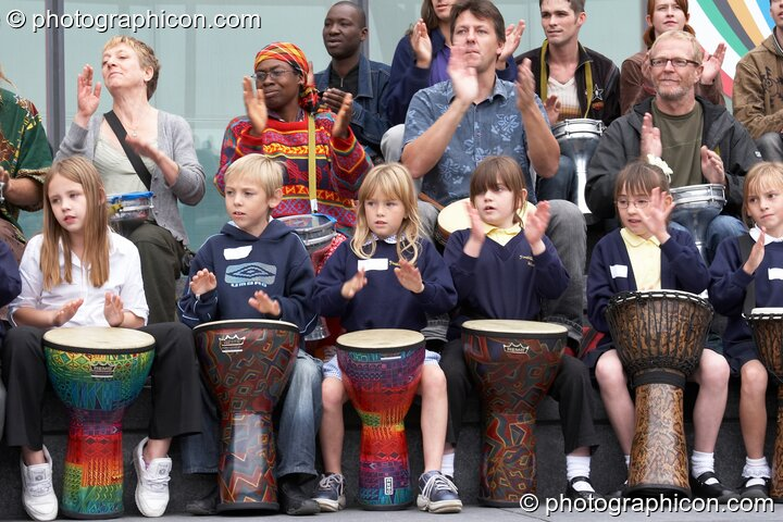 Shool kids performing with Drum4Africa, a fundraising project for African children, at the Thames Festival 2005. London, Great Britain. © 2005 Photographicon