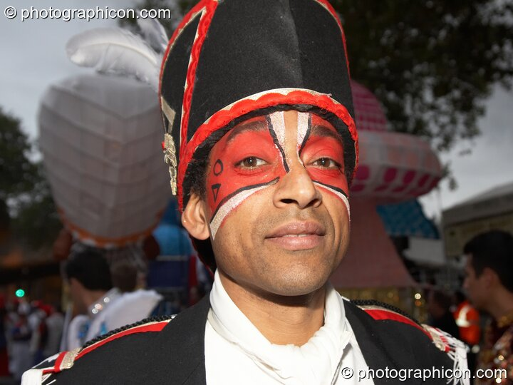 Man in costume participates in the carnival at the Thames Festival 2005. London, Great Britain. © 2005 Photographicon