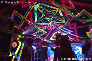 People dance amongst the lasers and decor in the Ninja Hippies tent at Waveform Project 2007. Kenton, Exeter, Great Britain. © 2007 Photographicon