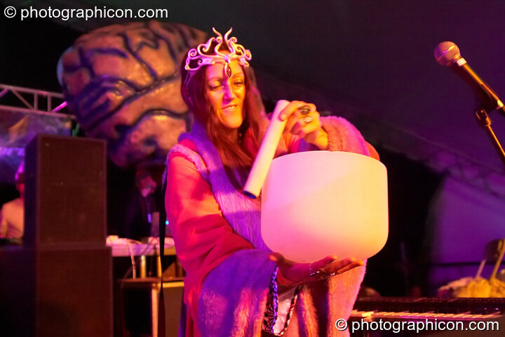 Ashera Hart performs with her sonic bowl as part of the Earthdance ritual on the Waveform main stage at Waveform Project 2007. Kenton, Exeter, Great Britain. © 2007 Photographicon