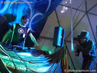 Gaudi (Interchill Records) DJs on the Gaia Chill stage while Matthew Cameron-Wilton takes photos at Waveform Project 2007. Kenton, Exeter, Great Britain. © 2007 Photographicon
