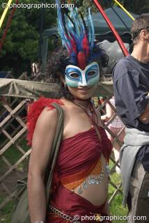 Woman wearing a masquerade face mask at Kingston Green Fair 2004. Kingston Upon Thames, Great Britain. © 2004 Photographicon