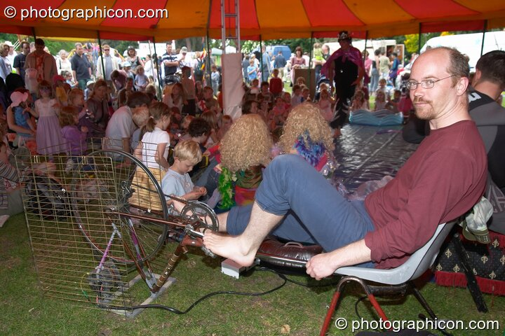 Campaign for Real Events provide pedal power for the Kidzone marquee at Kingston Green Fair 2005. Kingston Upon Thames, Great Britain. © 2005 Photographicon