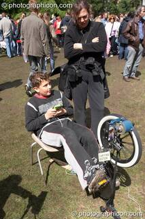 A boy plays some pedal-powered electronic games provided by The Campaign for Real Events at Kingston Green Fair 2006. Kingston upon Thames, Great Britain. © 2006 Photographicon