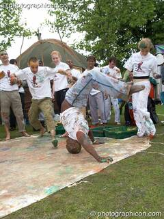 Rhythm Painting get messy with paint while performing Capoeira at Kingston Green Fair 2006. Kingston upon Thames, Great Britain. © 2006 Photographicon