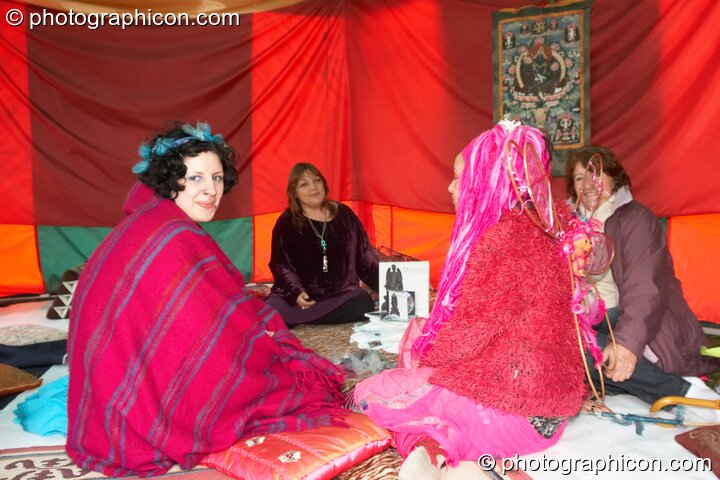 A group of women sit in quiet contemplation inside the Goddess Temple at Kingston Green Fair 2007. Kingston upon Thames, Great Britain. © 2007 Photographicon