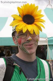 Howard Grange, Inspector of Green Police, wearing a large sunflower on his helmet at the London Green Lifestyle Show 2005. Great Britain. © 2005 Photographicon